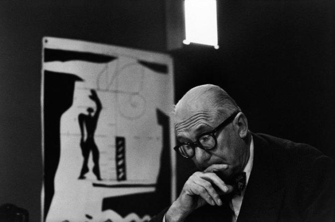 """FRANCE. Ile-de-France region. Paris. 1959. 7th arrondissement. 35, rue de Sèvres. The painter, architect and city planner LE CORBUSIER in the """"Atelier 35 S"""". On the left: a lithograph of his """"Modulor""""."""