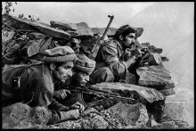 """AFGHN-10260, Nuristan, Afghanistan, 1979. CAPTION: Mujahideen Watch a Russian Convoy. Nuristan, Afghanistan,1979. Mujahideen fighters watch convoy, 1979""""After this photograph was published in The New York Times (in a vertical format), McCurry's career took off. Its publication identified McCurry as a photographer with inside knowledge and contacts as the conflict between the Soviet Union and Afghan nationals expanded. The image also heralded the photographer's intense, poetic approach to telling stories with an economy of means, strategically employing composition, light, and space as narrative tools. Here, for instance, the story is more powerfully told without seeing the Russian convoy the Mujahadeen fighters are so intensely observing, leaving the threat of their presence in mist outside the frame."""" - Phaidon 55 Mujahideen observe a Russian convoy, Nuristan, Afghanistan, 1979. Pg 16,17, Untold: The Stories Behind the Photographs Magnum Photos, NYC21021, MCS1980002 W00052/00A Steve Mccurry_Book Untold_Book final print_Beetles and Huxley MAX PRINT SIZE: 40X60 retouched_Sonny Fabbri 10/13/2015"""