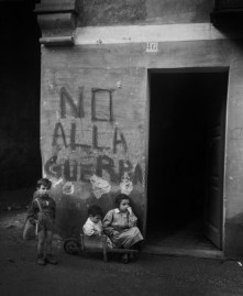 """ITALY. Genua. 1946. Writing on the wall: """"No alla guerra"""" (""""No to war""""). Italy was heavily affected by the Second World War: cities and infrastructure were largely reduced to rubble, and large portions of the population suffered from hunger and the loss of their homes."""