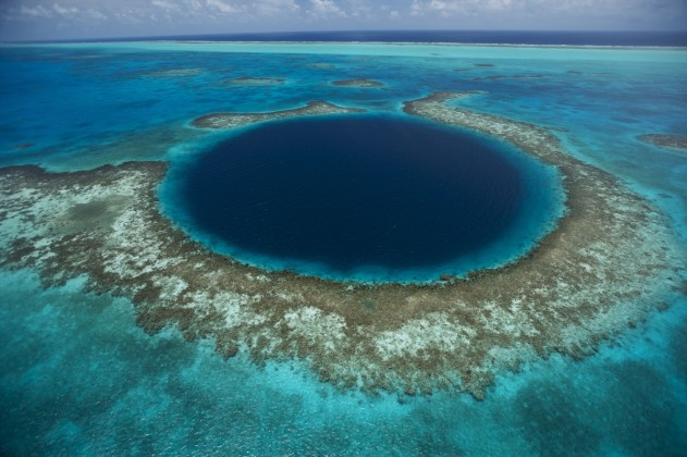 The Blue Hole at Lighthouse Reef in the middle of the 160-mile MesoAmerican Barrier Reef, the second largest barrier reef in the world. The Blue Hole is 400-feet deep and more than 1,000 feet across. It is a sunken cave that was flooded during the last ice age.