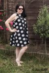 Flower summer dress featuring a white African Daisy on a black background
