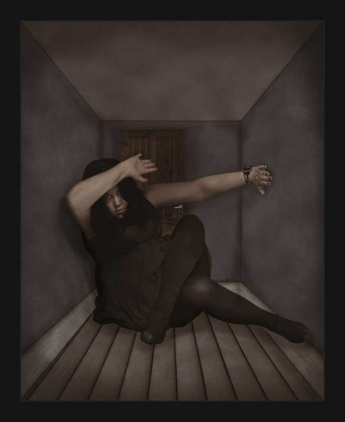 Alternative photo art, The walls are closing in! This lockdown inspired photograph shows a woman sat on the floor with the walls and ceiling closing in on her.
