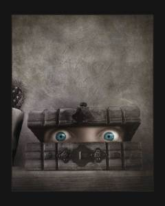 fine art photography - A pair of eyes peak out of a wooden box in this dark and surreal painterly art. This creepy art image is made up from an oversized face - too large from the box it is emerging from.