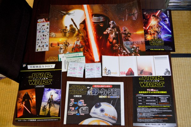 Star Wars galore!! We have: schedule stickers; a poster; some advertisement fliers; the movie vouchers and tickets; an accordion-style notepad; and a special newspaper-like pamphlet of the new movie that we got when we bought our vouchers from 7-11.