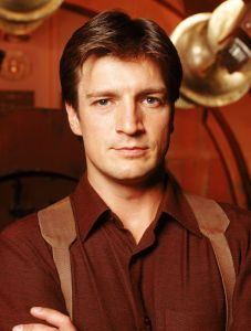 That is the smirk of a scoundrel and of a man that knows he's a nerd god. (Image courtesy of the Firefly Wiki)