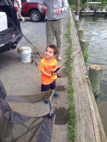 """My grandson Aiden fishing with his New fishing rod. It is a """"Dock Demon"""" by Zebco. These 30"""" rods are perfect for the little ones. The larger rods were somewhat overwhelming to him. This one was just right for his small stature."""