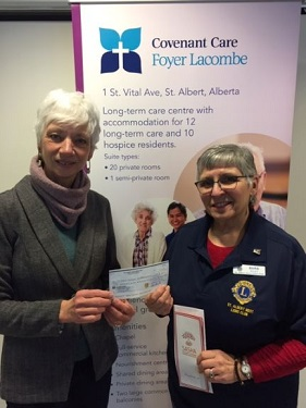 SASHA recieves cheque donated by Lion's Club