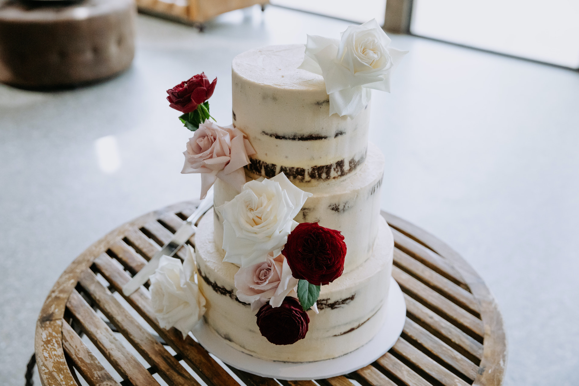 Stones of the Yarra Valley modern wedding cake with bright wedding flowers
