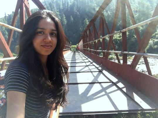 The bridge behind me sinks in the Uhl river below during monsoons.... Barot Valley, Himachal Pradesh, India