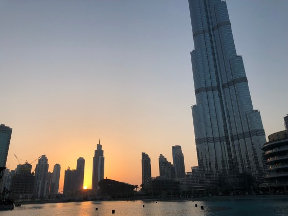 burj khalifa at sunset over lake
