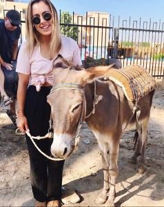Girl next to donkey in Egypt