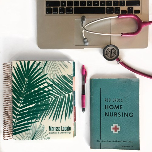 Nursing school books and laptop