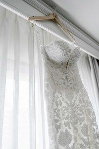 white pronovias wedding dress on hanger