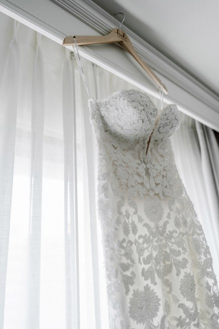 white pronovias wedding dress on hanger