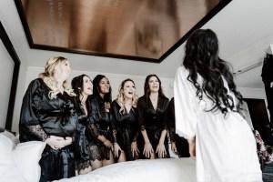bridesmaids in black robes