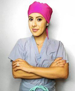 CRNA woman in scrubs pink scrub cap