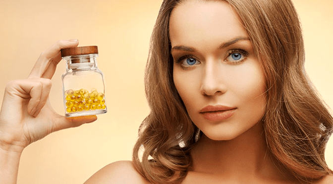 beautiful-woman-vitamins-fish-oil-blue-eyes