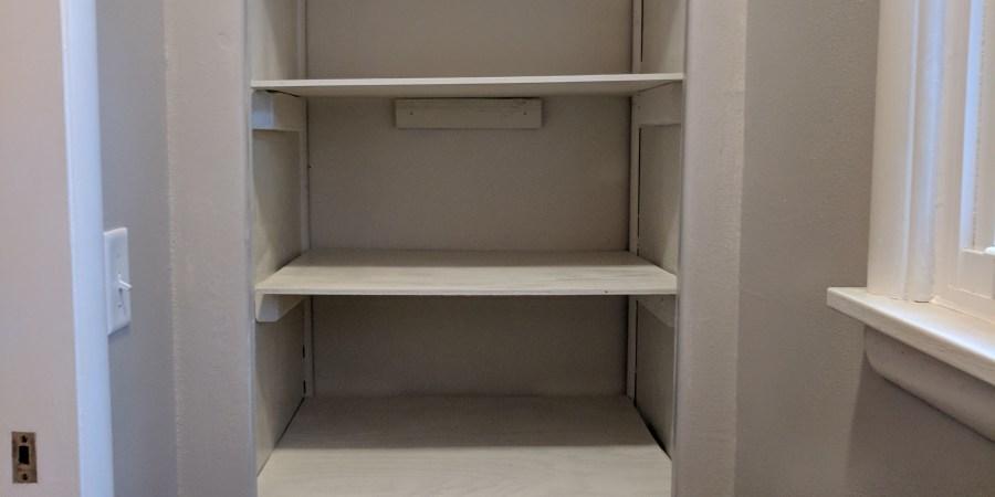Bathroom closet painted installed shelves