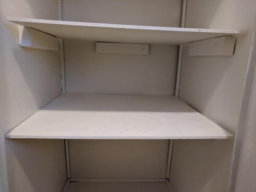 Bathroom closet painted shelves detail 4