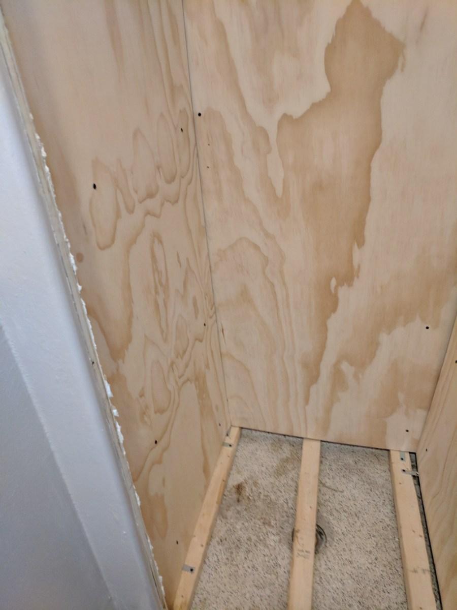 Bathroom closet plywood walls floor