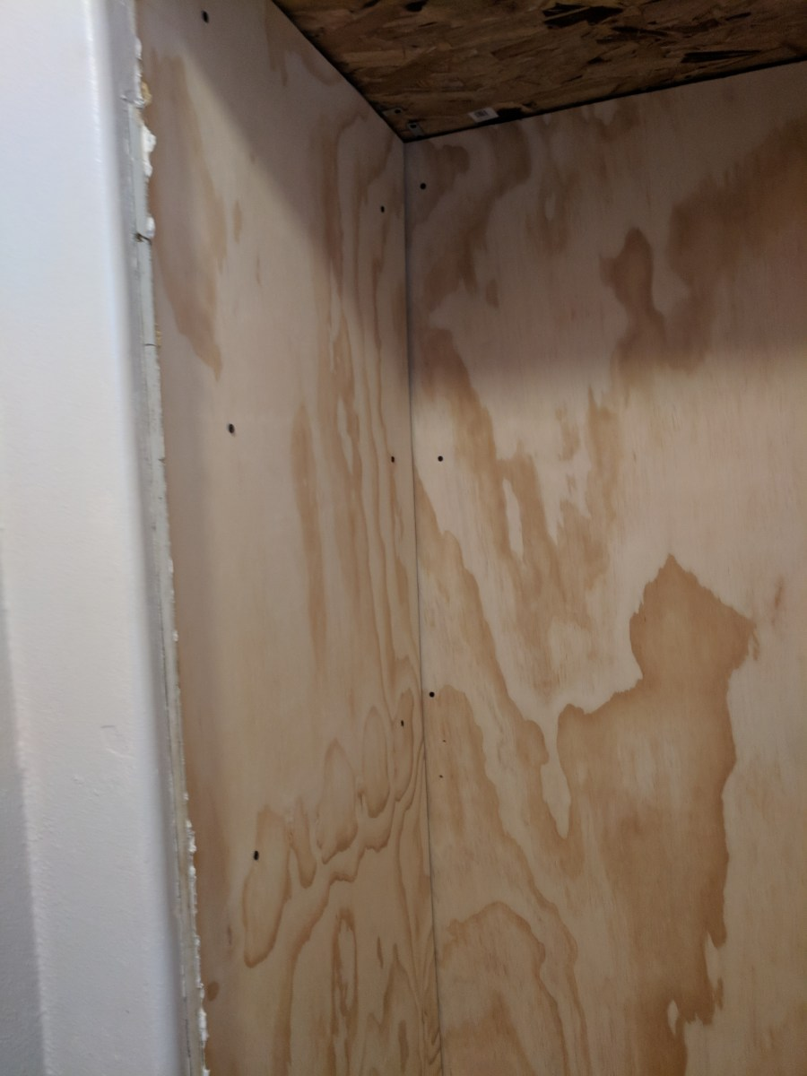 Bathroom closet plywood walls