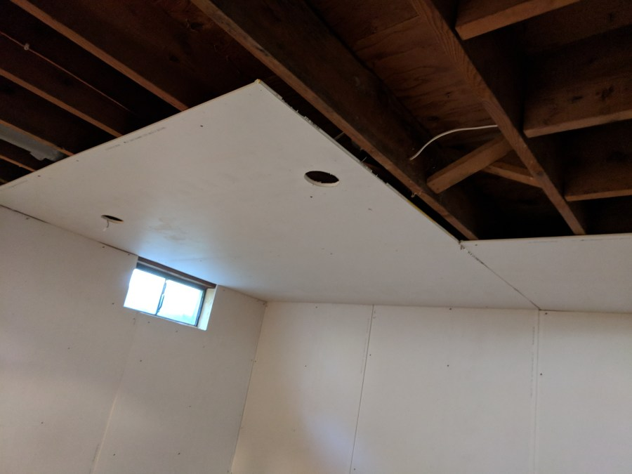 Ceiling drywall sheet with light