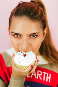 woman eating cupcake no guilt no self sabotage eat in moderation