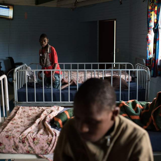 Patients at psychiatric institution bath in crocodile river because of no water