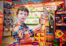 A kid shopping his favorite toys