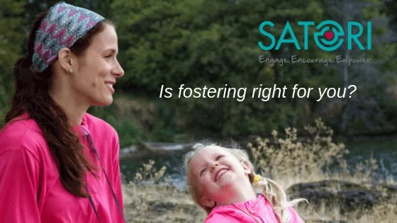 Foster parent smiling happily with foster child