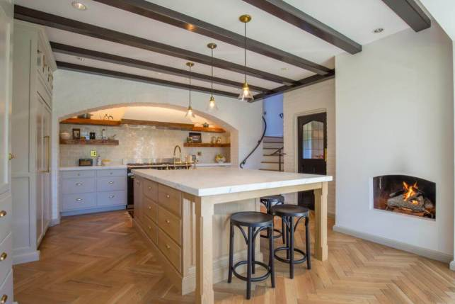 Chef Kitchen With Fireplace and Beams