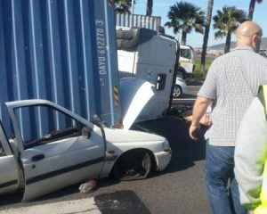 Truck overturns onto car killing two and injuring one in Woodstock