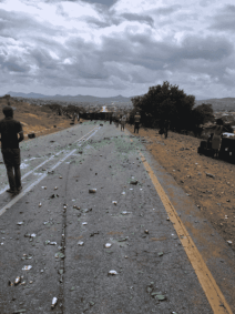 Bus and truck collide leaving one dead, sixteen injured
