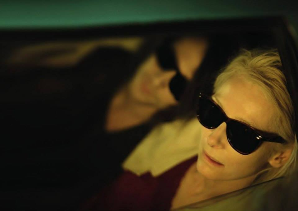 lovers laying beside each other with sunglasses tilda swinton look the other way on saturdaysoul.com blog