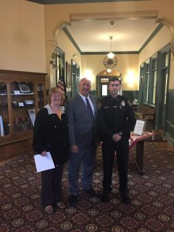 Officer Maes was sworn into the Saugus Police Department in June at Saugus Town Hall. Left-to-right: Mother Kathleen Maes, Chief Domenic DiMella and Officer Jonathan Maes. (Courtesy Photo)
