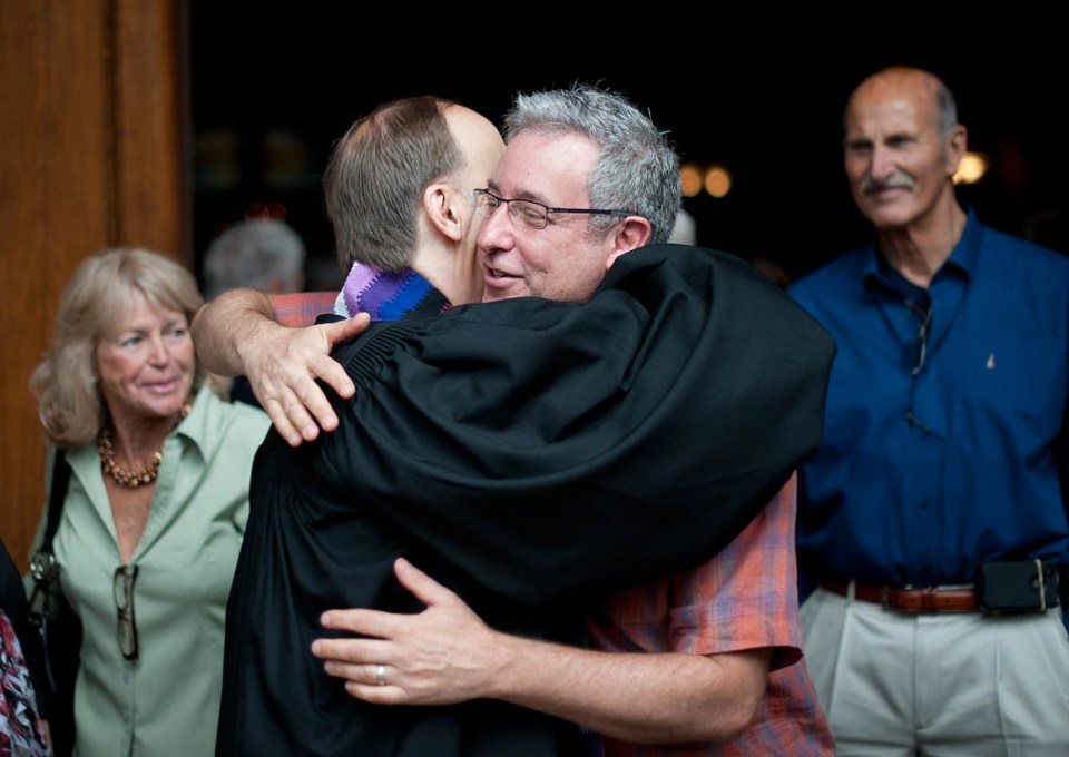 Joe Silverman (R) hugs his partner of 26 years Rev. Paul Mowry following Sunday service at Sausalito Presbyterian Church in Sausalito