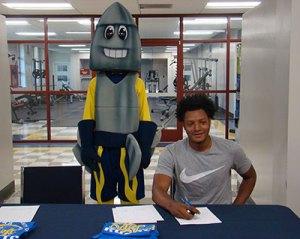 young black man and rocket mascot