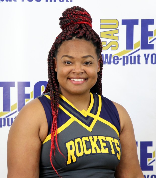 young black woman in cheer uniform
