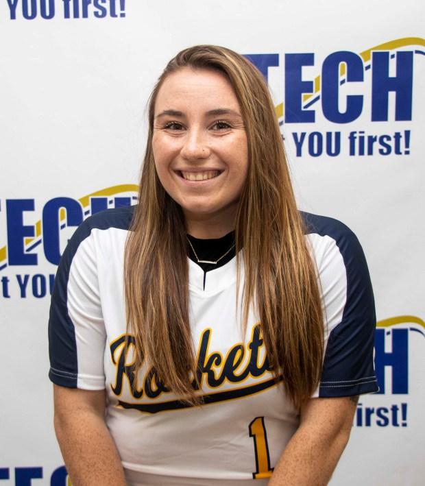white girl in softball uniform