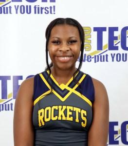 Young black girl in cheer uniform