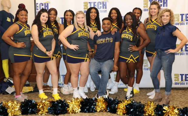 Group of cheerleaders and a young white woman