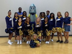 group of cheerleaders and rocket mascot