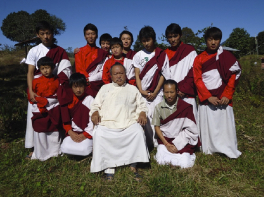Lopon P. Ogyan Tandzin Rinpoche (front), a ngakpa and student of Dudjom Rinpoche with students from the ngakpa school or dratsang which he founded in 2001 and which is located in a remote border region of Arunachal Pradesh, India