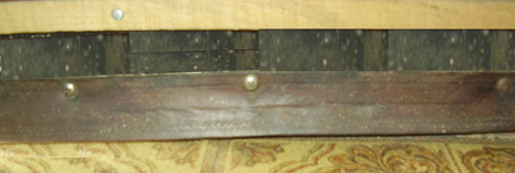 The old leather belt works great as a long-lasting door-sweep.