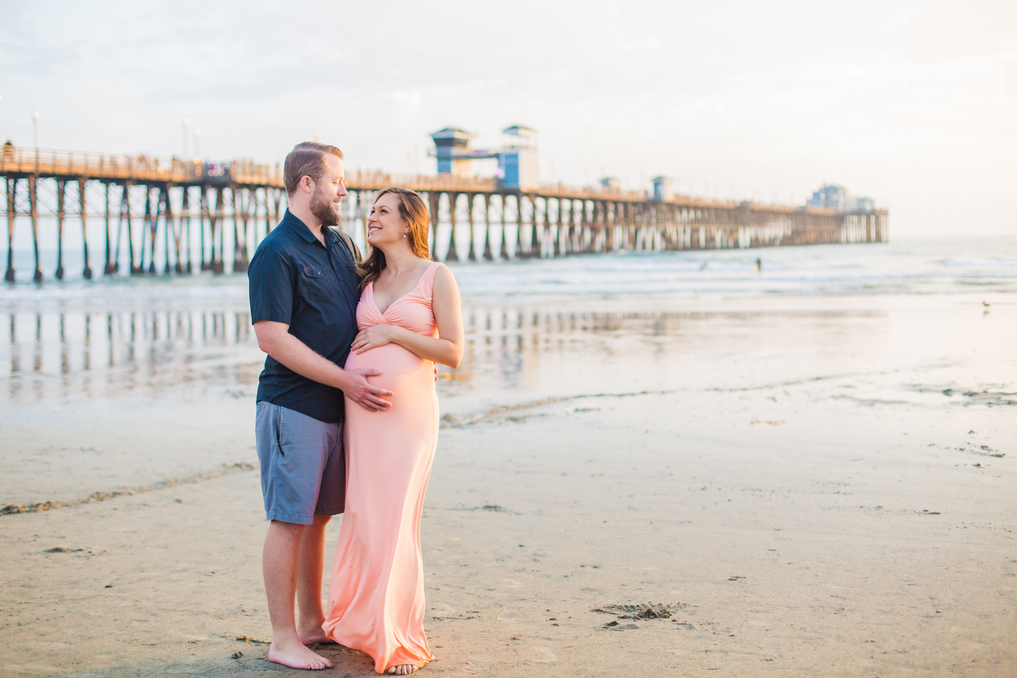 Sunset pier maternity session picture in Oceanside, California