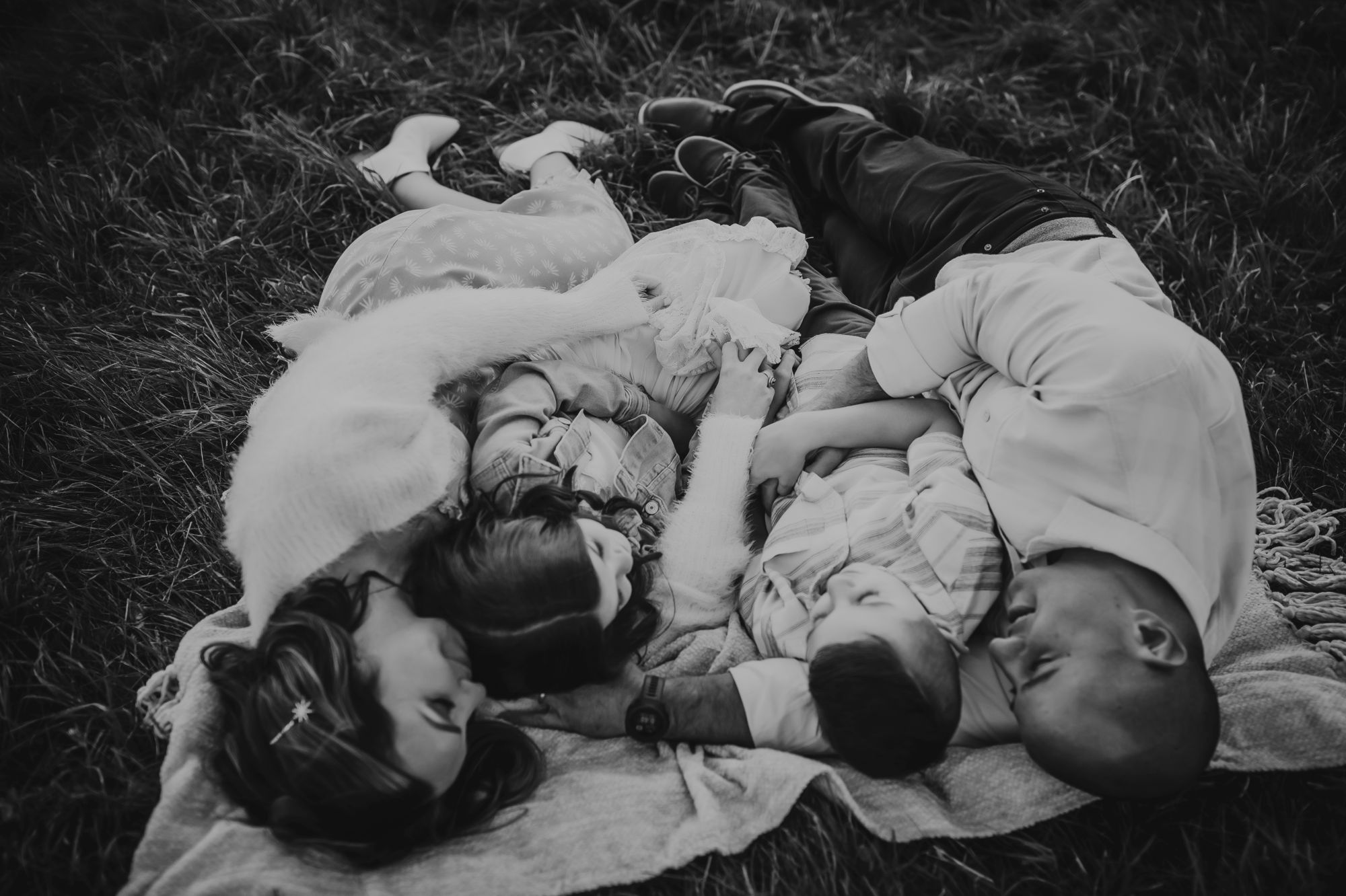 Family laying in field Trapp Lodge