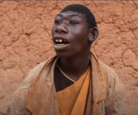 Rwanda boy monkey