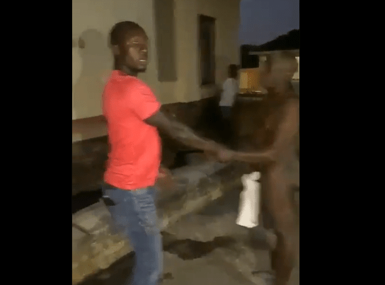 Video: Man moers naked man and escorts him to his family after catching him sleeping with his wife