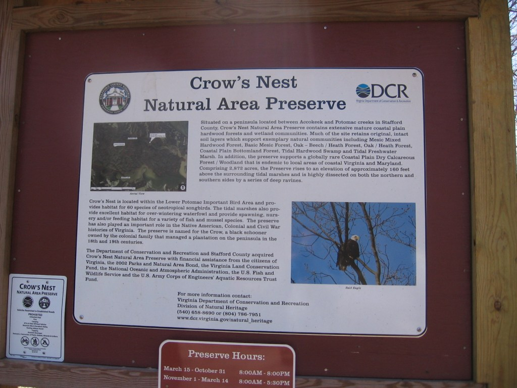 The site features a parking lot where a variety of signage informs visitors about the surroundings.