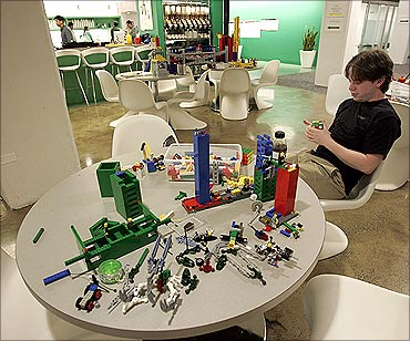 An employee plays with lego at the New York City offices of Google.